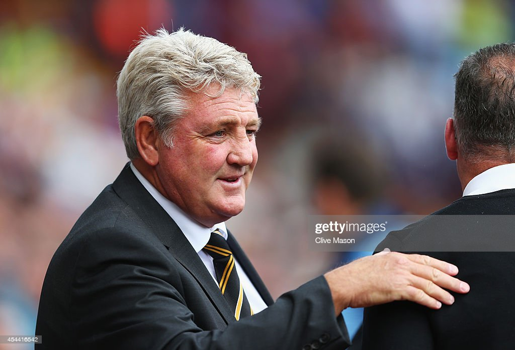 Steve Bruce, manager of Hull City greets Paul Lambert, manager of Aston Villa during the Barclays Premier League match between Aston Villa and Hull City at Villa Park on August 31, 2014 in Birmingham, England.