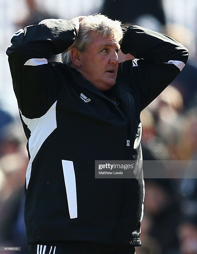 <a gi-track='captionPersonalityLinkClicked' href=/galleries/search?phrase=Steve+Bruce+-+Soccer+Manager&family=editorial&specificpeople=208832 ng-click='$event.stopPropagation()'>Steve Bruce</a>, manager of Hull City looks on during the npower Championship match between Barnsley and Hull City at Oakwell Stadium on April 27, 2013 in Barnsley, England.