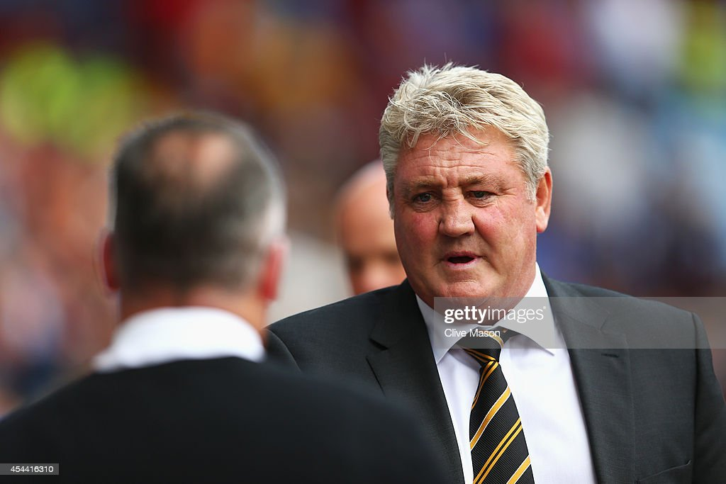 Steve Bruce, manager of Hull City walks to shake hands with Paul Lambert, manager of Aston Villa during the Barclays Premier League match between Aston Villa and Hull City at Villa Park on August 31, 2014 in Birmingham, England.