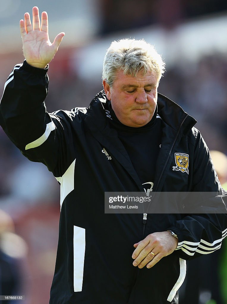 <a gi-track='captionPersonalityLinkClicked' href=/galleries/search?phrase=Steve+Bruce+-+Soccer+Manager&family=editorial&specificpeople=208832 ng-click='$event.stopPropagation()'>Steve Bruce</a>, manager of Hull City waves to the travelling supporters after the npower Championship match between Barnsley and Hull City at Oakwell Stadium on April 27, 2013 in Barnsley, England.