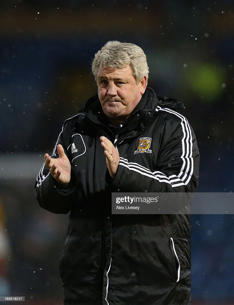 Steve Bruce the manager of Hull City applauds his supporters after the npower Championship match between Burnley and Hull City at Turf Moor on March 11, 2013 in Burnley, England.