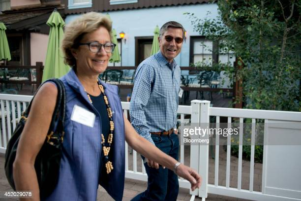 Steve Burke chief executive officer of NBC Universal walks with Gretchen Burke as they arrive for a morning session during the Allen Co Media and...