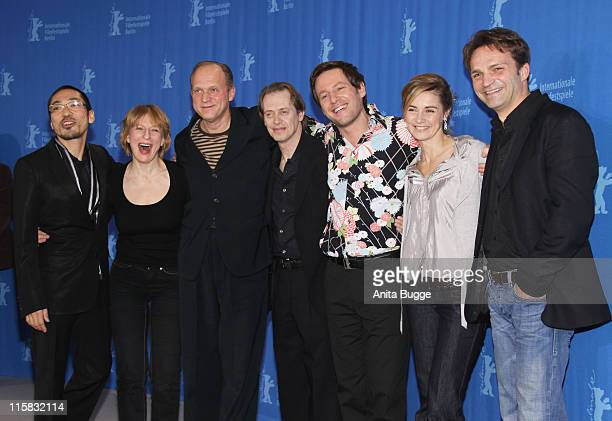 Steve Buscemi Ulrich Tukur Dagmar Manzel director Florian Gallenberger and Anne Consigny pose with guests as they attend the 'John Rabe' photocall...