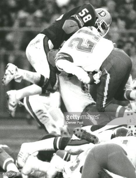 Steve Busick slams into Charger running back Buford McGee during Denver goal line stand which held San Diego four time inside the 1 yard line Credit...