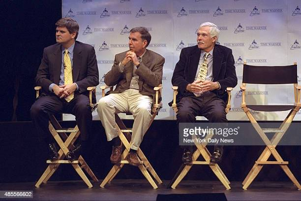 Steve Case Chairman and CEO of America Online Gerald Levin chairman and CEO of Time Warner and Ted Turner Vice Chairman of Time Warner sit together...
