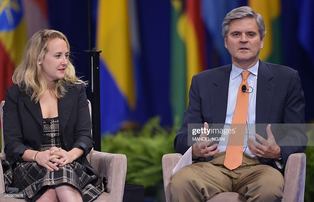 Steve Case of Revolution LLC speaks during a plenary session watched by Alexa von Tobel of LearnVest.com during the Washington Fellowship for Young African Leaders Presidential Summit on July 30, 2014 at a hotel in Washington, DC. AFP PHOTO/Mandel NGAN