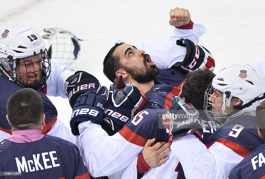 <a gi-track='captionPersonalityLinkClicked' href=/galleries/search?phrase=Steve+Cash&family=editorial&specificpeople=6838574 ng-click='$event.stopPropagation()'>Steve Cash</a> of the United States celebrates after USA win the ice sledge hockey gold medal game against the Russian Federation and the United States of America at the Shayba Arena during day eight of the 2014 Paralympic Winter Games on March 15, 2014 in Sochi, Russia. (Photo by Justin Setterfield/Getty Images