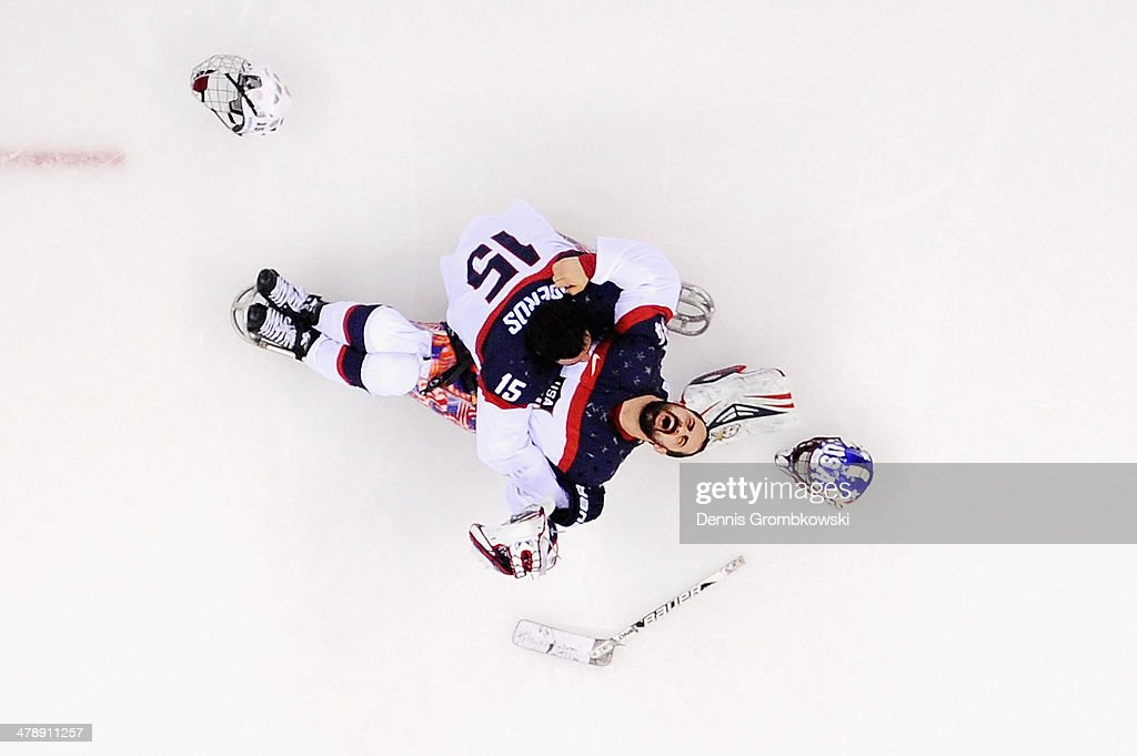 Steve Cash of the United States celebrates winning the gold medal with Nikko Landeros after the Ice Sledge Hockey Gold Medal game between the United States and Russia on day eight of the Sochi 2014 Paralympic Winter Games at Shayba Arena on March 15, 2014 in Sochi, Russia.