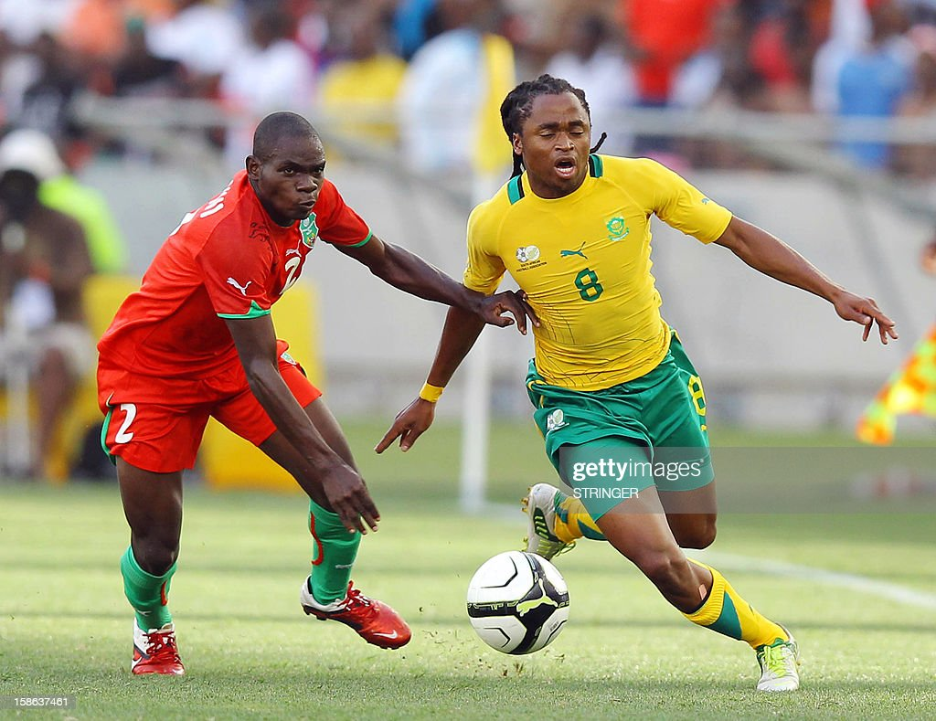 Steve Chagoma of Malawi and South Africa's Siphiwe Tshabalala (R) fight for the ball during the International friendly match between South Africa and Malawi at Moses Mabhida Stadium on December 22, 2012 in Durban, South Africa, one month before South Africa host the Orange Africa Cup of Nations, CAN