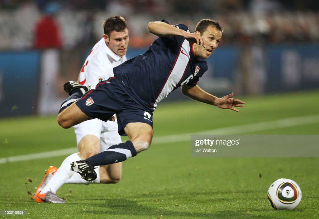 Steve Cherundolo of the United States is tackled by James Milner of England during the 2010 FIFA World Cup South Africa Group C match between England...