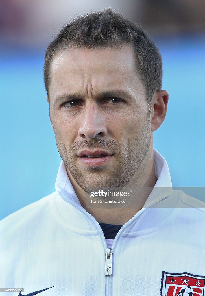 Steve Cherundolo of USA stands for the playing of the national anthems before their game against Canada during their international friendly match on...