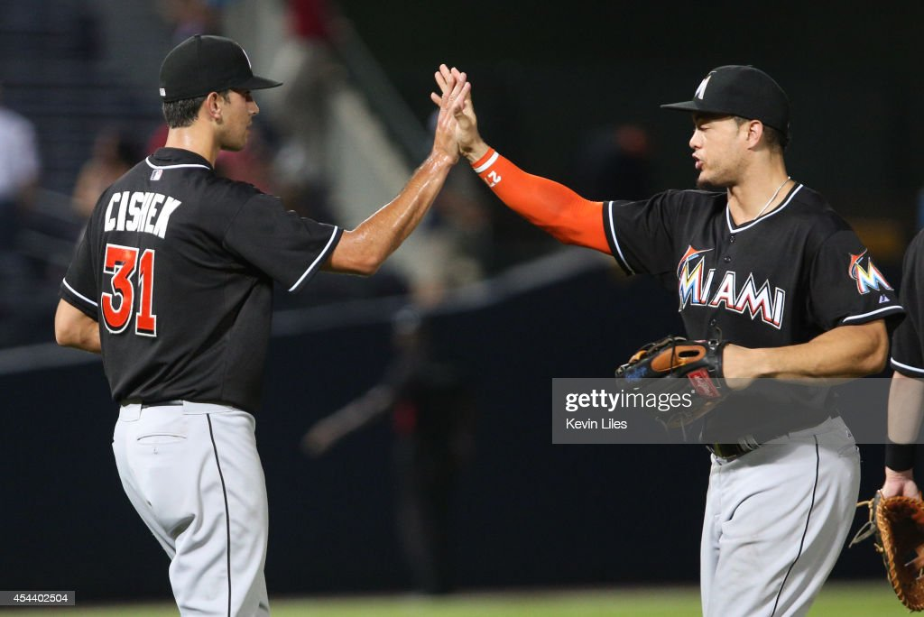<a gi-track='captionPersonalityLinkClicked' href=/galleries/search?phrase=Steve+Cishek&family=editorial&specificpeople=7542919 ng-click='$event.stopPropagation()'>Steve Cishek</a> #31 of the Miami Marlins celebrates with teammate <a gi-track='captionPersonalityLinkClicked' href=/galleries/search?phrase=Giancarlo+Stanton&family=editorial&specificpeople=8983978 ng-click='$event.stopPropagation()'>Giancarlo Stanton</a> #27 after defeating the Atlanta Braves 4-0 at Turner Field on August 30, 2014 in Atlanta, Georgia.