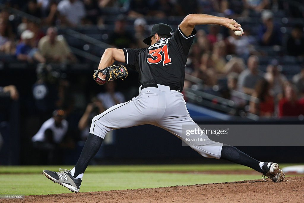 <a gi-track='captionPersonalityLinkClicked' href=/galleries/search?phrase=Steve+Cishek&family=editorial&specificpeople=7542919 ng-click='$event.stopPropagation()'>Steve Cishek</a> #31 of the Miami Marlins pitches against the Atlanta Braves during the ninth inning at Turner Field on August 30, 2014 in Atlanta, Georgia.