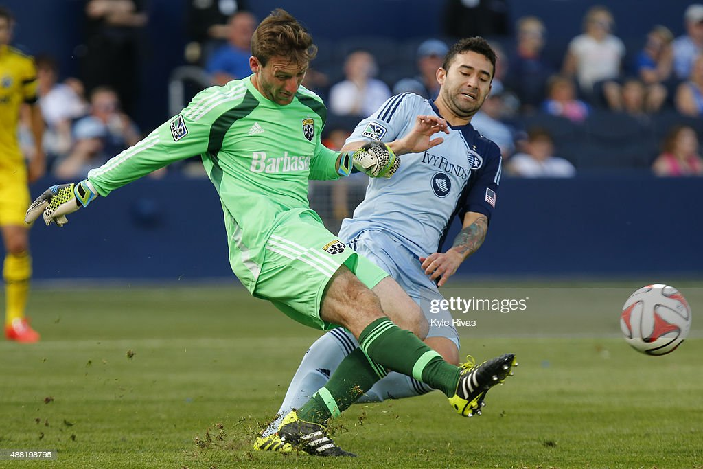 Steve Clark #1 of Columbus Crew clears the ball before being taken down by Hassan Ali 'Soony' Saad #22 of Sporting KC late in the second half on May 4, 2014 at Sporting Park in Kansas City, Kansas.