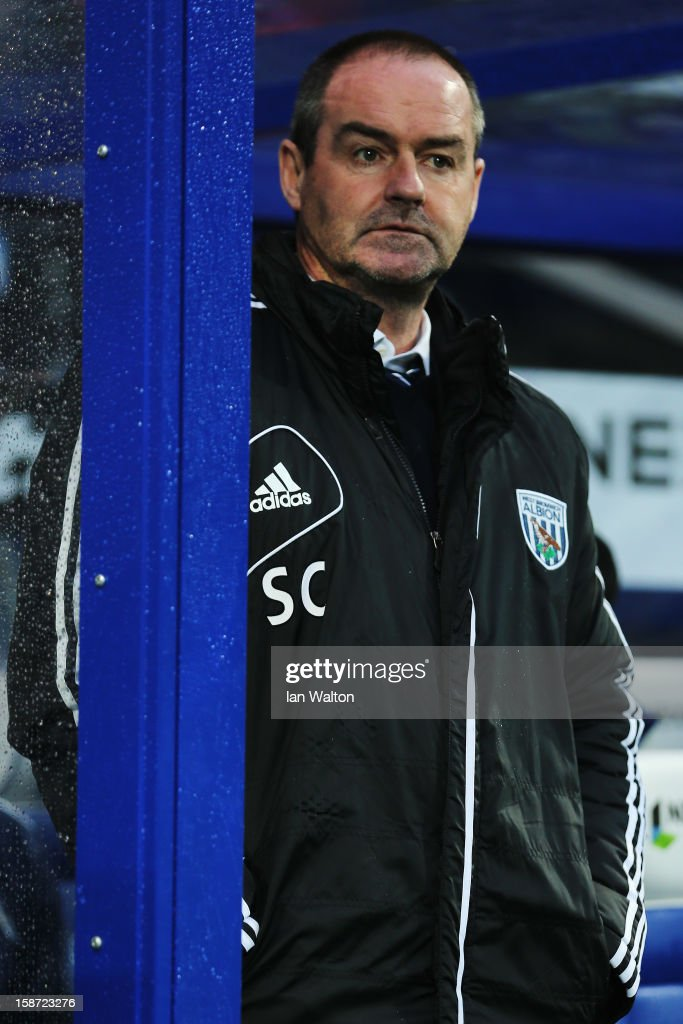 Steve Clarke the West Bromwich Albion manager looks on during the Barclays Premier League match between Queens Park Rangers and West Bromwich Albion at Loftus Road on December 26, 2012 in London, England.