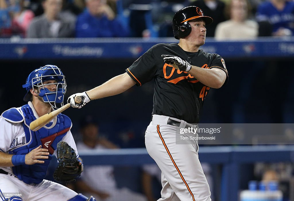 Steve Clevenger #45 of the Baltimore Orioles hits a two-run double in the seventh inning during MLB game action against the Toronto Blue Jays on September 13, 2013 at Rogers Centre in Toronto, Ontario, Canada.