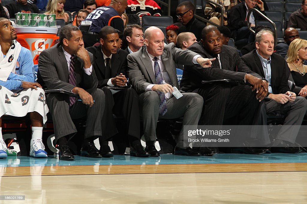 Steve Clifford, Coach of the Charlotte Bobcats confers with his assistant coaches Stephen Silas and Patrick Ewing during the game against the Cleveland Cavaliers during the game at the Time Warner Cable Arena on October 24, 2013 in Charlotte, North Carolina.