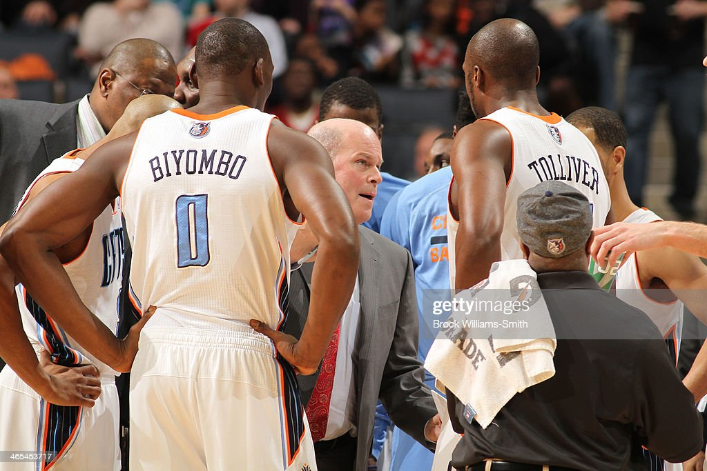 Steve Clifford, Head Coach of the Charlotte Bobcats confers with his team during the game against the Chicago Bulls at the Time Warner Cable Arena on January 25, 2014 in Charlotte, North Carolina.