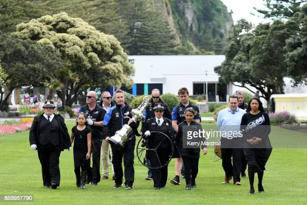 Steve Collie carries the America's Cup along the Marine Parade before the civic reception during the America's Cup Regional Tour on October 11 2017...