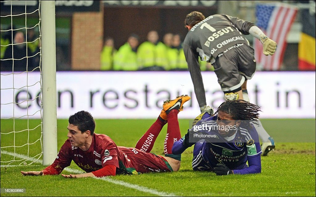 Steve Colpaert of SV Zulte Waregem and Mbokani Dieumerci of Rsc Anderlecht in action during the Jupiler League match between RSC Anderlecht and SV Zulte Waregem on February 27, 2013 in Anderlecht, Belgium.