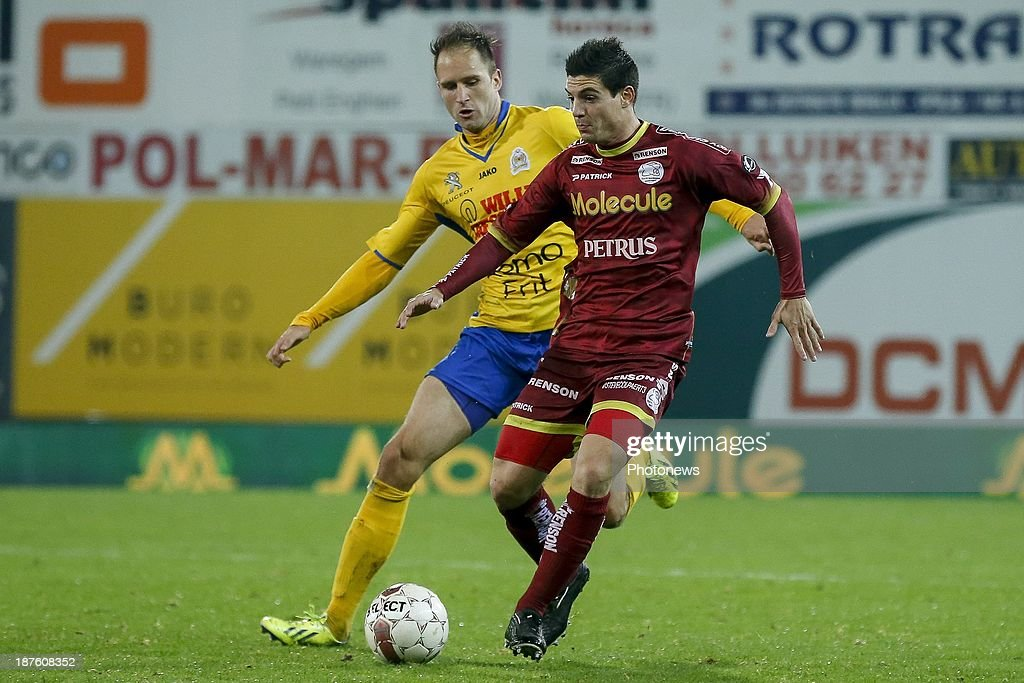 Steve Colpaert of Zulte Waregem and Dalibor Veselinovic of Waasland Beveren during the Jupiler Pro League match between Zulte Waregem and Waasland Beveren on November 10, 2013 in Waregem, Belgium.