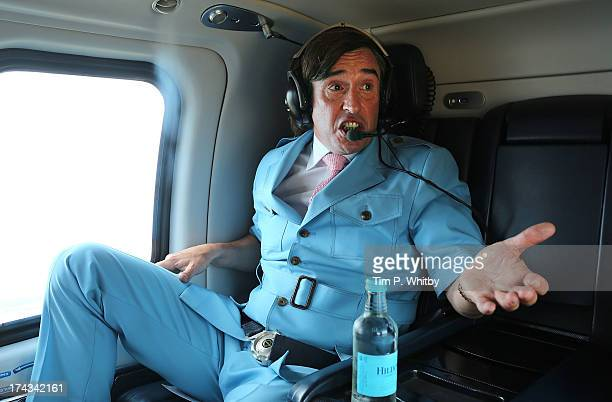 Steve Coogan as Alan Partridge travels by helicopter from Norwich to London after attending the 'Alan Partridge Alpha Papa' World Premiere Day at...