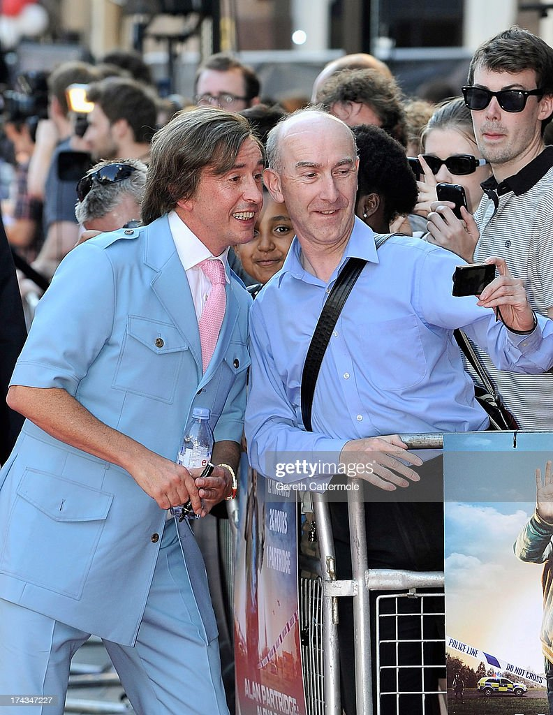 Steve Coogan in character as Alan Partridge (L) poses with fan as he attends the London Premiere of 'Alan Partidge: Alpha Papa' at Vue Leicester Square on July 24, 2013 in London, England.