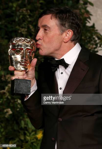 Steve Coogan with award attends an official dinner party after the EE British Academy Film Awards at The Grosvenor House Hotel on February 16 2014 in...