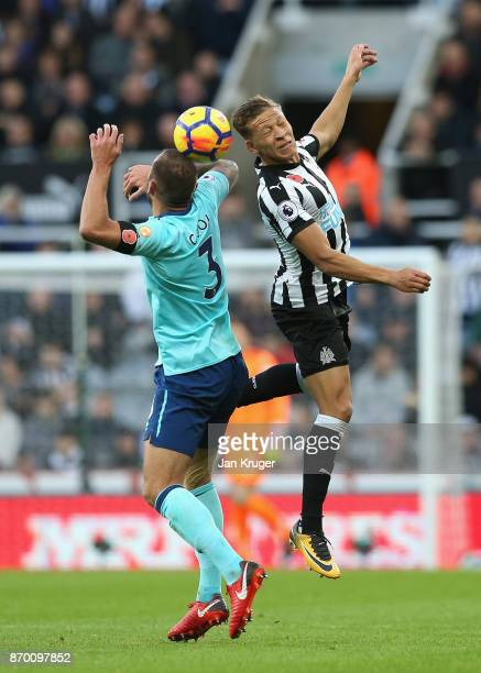 Steve Cook of AFC Bournemouth and Dwight Gayle of Newcastle United battle for possession in the air during the Premier League match between Newcastle...