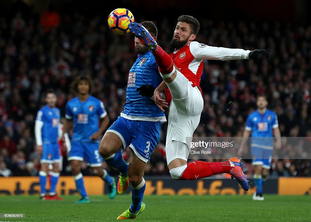 Steve Cook of AFC Bournemouth (L) and Olivier Giroud of Arsenal (R) battle for possession during the Premier League match between Arsenal and AFC Bournemouth at Emirates Stadium on November 27, 2016 in London, England.