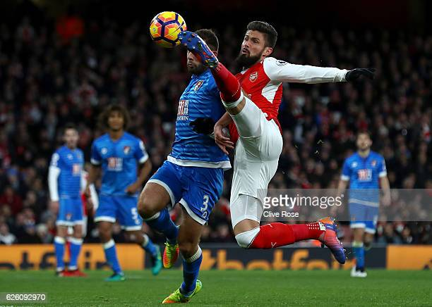 Steve Cook of AFC Bournemouth and Olivier Giroud of Arsenal battle for possession during the Premier League match between Arsenal and AFC Bournemouth...