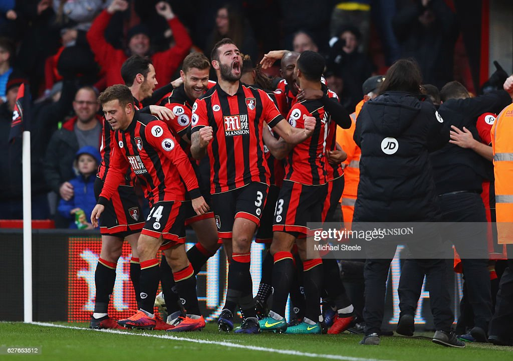 Steve Cook of AFC Bournemouth (3) celebrates with team mates as Nathan Ake of AFC Bournemouth scores their fourth goal during the Premier League match between AFC Bournemouth and Liverpool at Vitality Stadium on December 4, 2016 in Bournemouth, England.