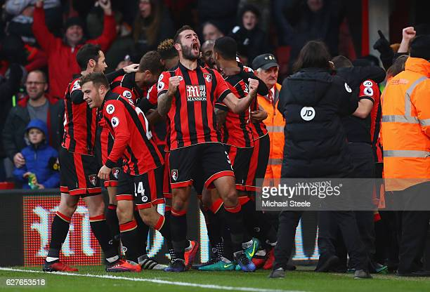 Steve Cook of AFC Bournemouth celebrates with team mates as Nathan Ake of AFC Bournemouth scores their fourth goal during the Premier League match...