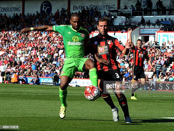 Steve Cook of AFC Bournemouth tackles Jermain Defoe of Sunderland during the Barclays Premier League match between AFC Bournemouth and Sunderland at...