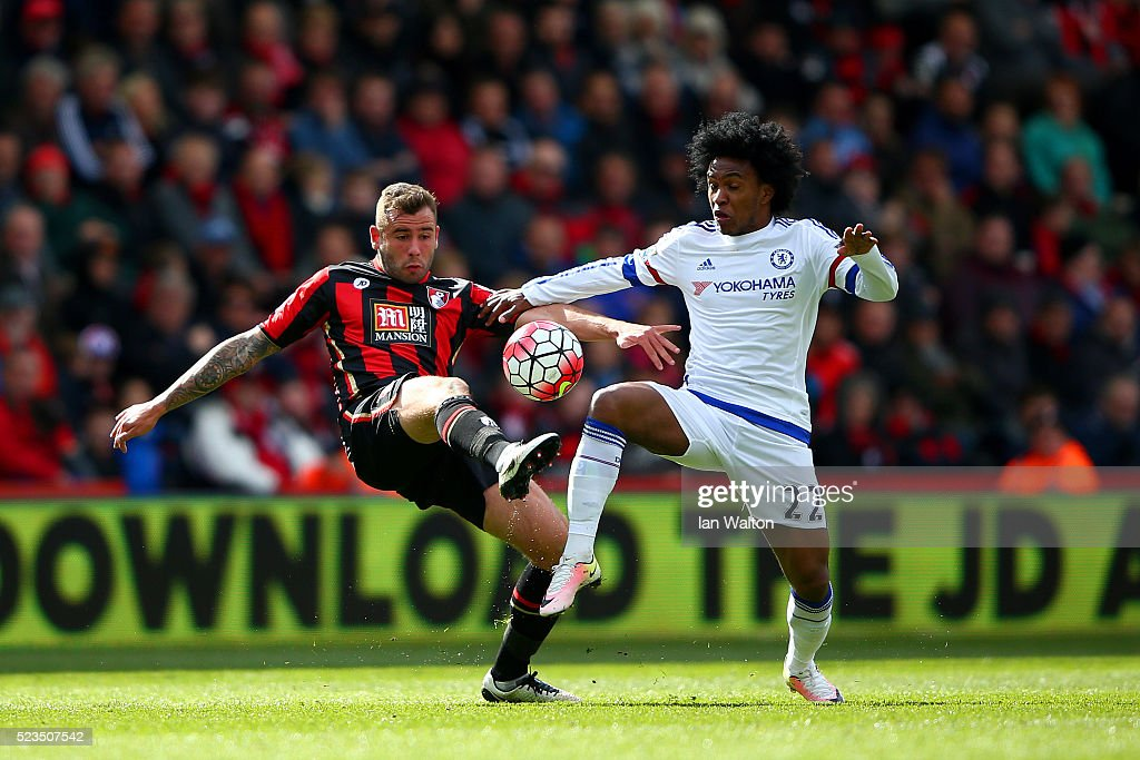 Steve Cook of Bournemouth and Willian of Chelsea in action during the Barclays Premier League match between A.F.C. Bournemouth and Chelsea at the Vitality Stadium on April 23, 2016 in Bournemouth, United Kingdom.