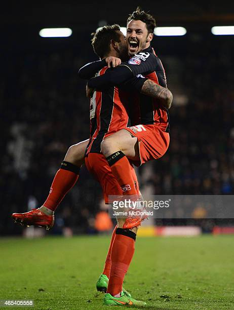Steve Cook of Bournemouth celebrates with Adam Smith as he scores their fifth goal during the Sky Bet Championship match between Fulham and AFC...
