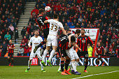 Steve Cook of Bournemouth heads the ball to score his team's third goal during the Barclays Premier League match between AFC Bournemouth and Swansea...
