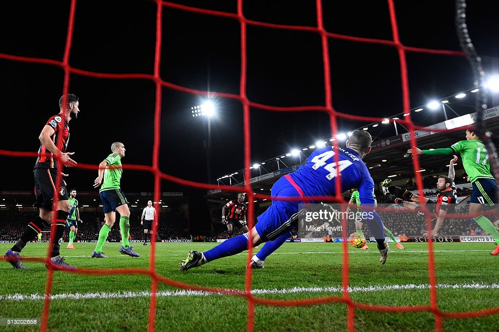 Steve Cook (2nd R) of Bournemouth scores his team's first goal during the Barclays Premier League match between A.F.C. Bournemouth and Southampton at Vitality Stadium on March 1, 2016 in Bournemouth, England.