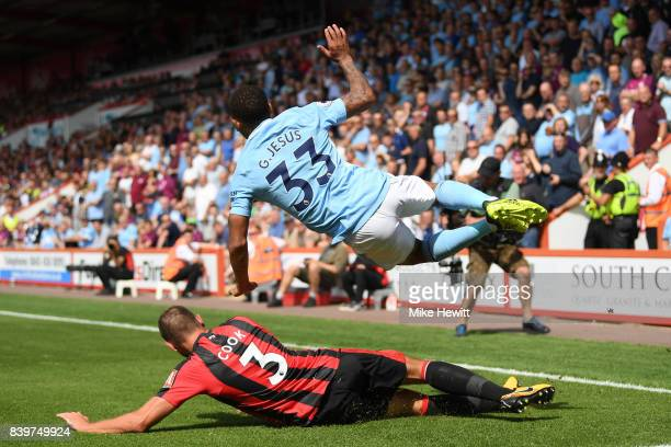 Steve Cook of Bournemouth tackles Gabriel Jesus of Manchester City during the Premier League match between AFC Bournemouth and Manchester City at...