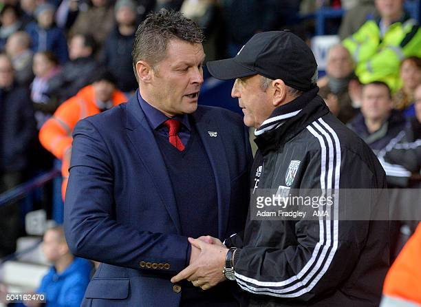 Steve Cotterill of Bristol City and Tony Pulis head coach / manager of West Bromwich Albion during The Emirates FA Cup 3rd Round Match between West...