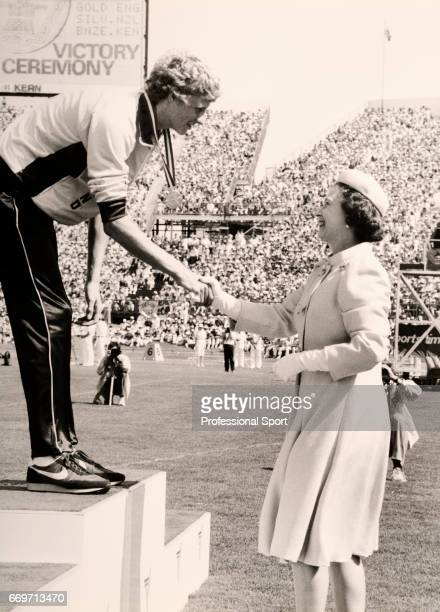 Steve Cram of England receiving his Gold Medal from HM The Queen after his victory in the 1500 Metres event during the Commonwealth Games held in...