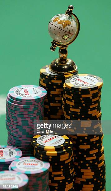 Steve Dannenmann's globe sits on top of his pile of poker chips during the sixth round of the World Series of Poker nolimit Texas Hold 'em main event...