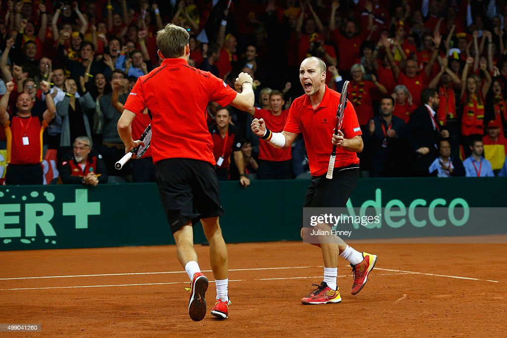 <a gi-track='captionPersonalityLinkClicked' href=/galleries/search?phrase=Steve+Darcis&family=editorial&specificpeople=4354952 ng-click='$event.stopPropagation()'>Steve Darcis</a> and <a gi-track='captionPersonalityLinkClicked' href=/galleries/search?phrase=David+Goffin&family=editorial&specificpeople=2291768 ng-click='$event.stopPropagation()'>David Goffin</a> of Belgium celebrate winning the second set against Jamie Murray and Andy Murray of Great Britain in the doubles during day two of the Davis Cup Final between Belgium and Great Britain at Flanders Expo on November 28, 2015 in Ghent, Belgium.
