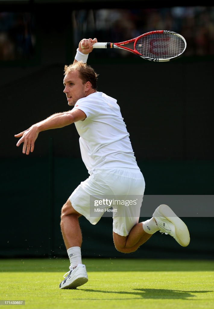 <a gi-track='captionPersonalityLinkClicked' href=/galleries/search?phrase=Steve+Darcis&family=editorial&specificpeople=4354952 ng-click='$event.stopPropagation()'>Steve Darcis</a> of Belgium hits a forehand during his Gentlemen's Singles first round match against Rafael Nadal of Spain on day one of the Wimbledon Lawn Tennis Championships at the All England Lawn Tennis and Croquet Club on June 24, 2013 in London, England.