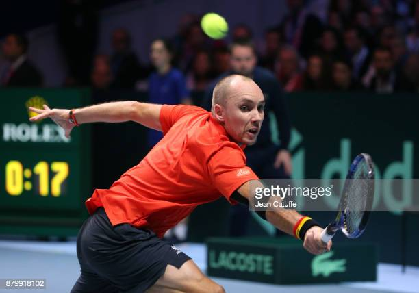 Steve Darcis of Belgium in action against Lucas Pouille of France during day 3 of the Davis Cup World Group final between France and Belgium at Stade...