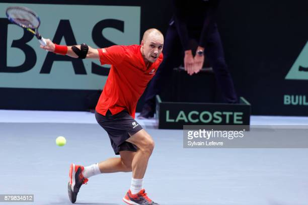 Steve Darcis of Belgium in action against Lucas Pouille of France during his match during day 3 of the Davis Cup World Group final between France and...