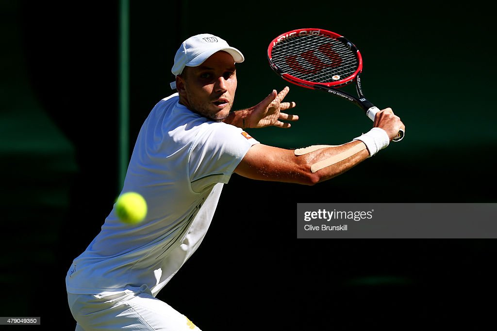 <a gi-track='captionPersonalityLinkClicked' href=/galleries/search?phrase=Steve+Darcis&family=editorial&specificpeople=4354952 ng-click='$event.stopPropagation()'>Steve Darcis</a> of Belgium in action in his Gentlemen's Singles first round match against Feliciano Lopez of Spain during day two of the Wimbledon Lawn Tennis Championships at the All England Lawn Tennis and Croquet Club on June 30, 2015 in London, England.