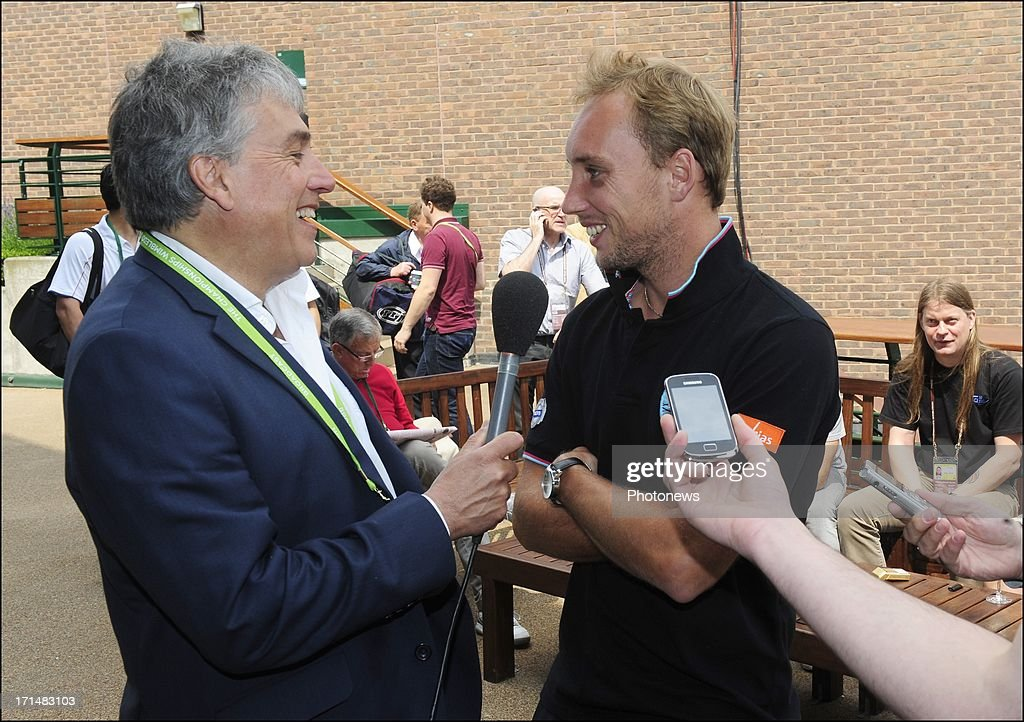 Steve Darcis of Belgium (R) is interviewed by John Inverdale (L), the day after his victory against Nadal on day one of Wimbledon on 25 June, 2013 in London, England.