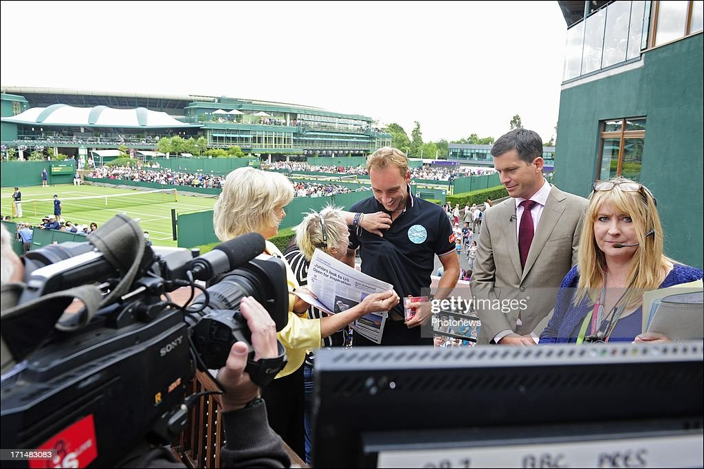 Steve Darcis of Belgium (C) pictured with Sue Barker of the BBC and former tennis player Tim Henman, the day after his victory against Nadal on day one of Wimbledon on 25 June, 2013 in London, England.