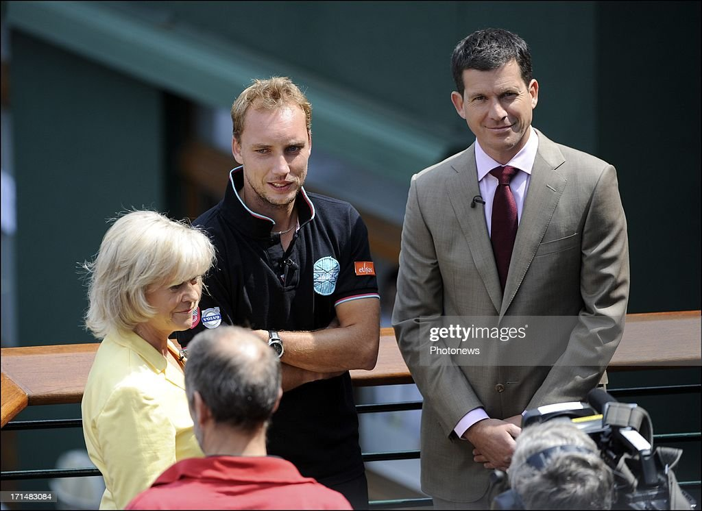 Steve Darcis of Belgium (C) pictured with Sue Barker of the BBC (L) and former tennis player Tim Henman (R), the day after his victory against Nadal on day one of Wimbledon on 25 June, 2013 in London, England.